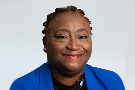 Image of Black Woman smiling in blue suit